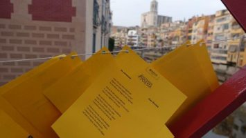 Poems written on these yellow coloured paper and pasted all over the red bridge