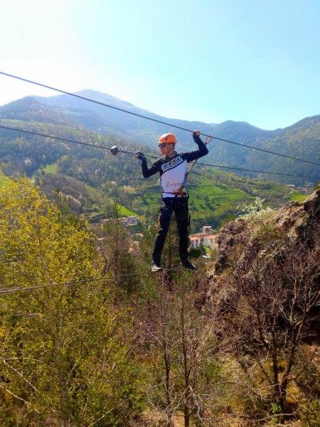 Cez walking one of the steel ladders in the route. Can you spot the Pyrenees in the background?
