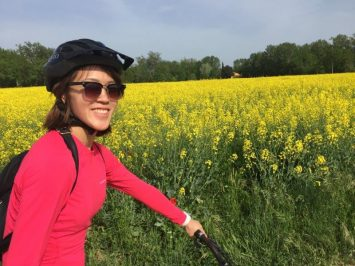 Cycling past the yellow golden flower fields with our helmets and powerful mountain bikes.