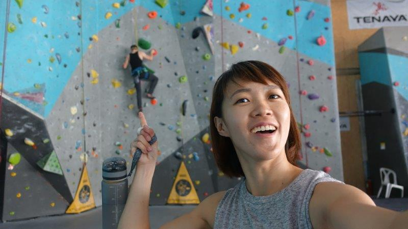Warm up on an easy auto belay routes in rock domain climbing gym Bangkok