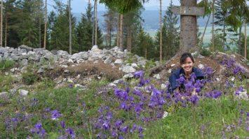 Lisa in the sea of beautiful purple Cypripedium calceolus flowers