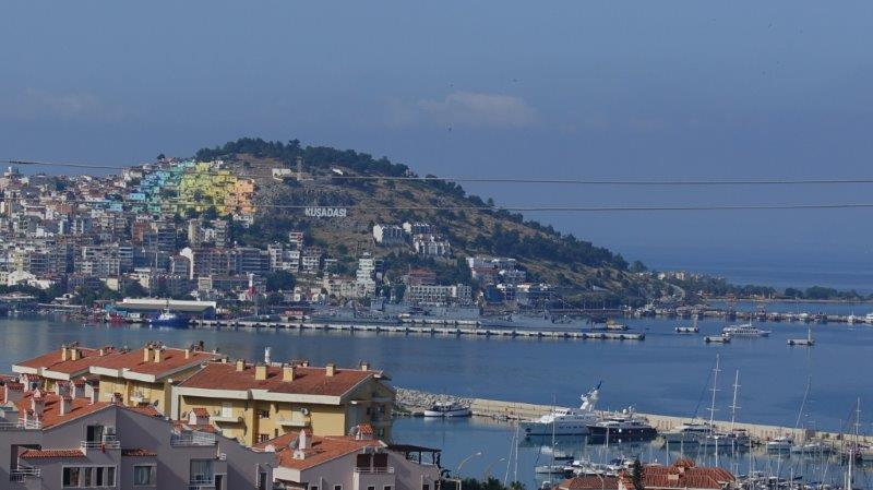 Prominent Kusadasi hill with the view of the Mediterranean sea | Can you spot the colourful houses on the hill