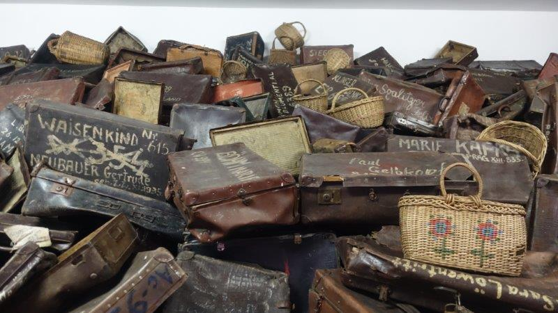 Suitcases stacked in Auschwitz