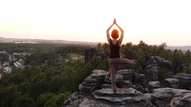 Yoga at sunset at Tisa Rock