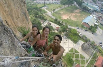 Batu Caves Rock Climbing, hanging from a multi pitch point on the wall. What a great view!