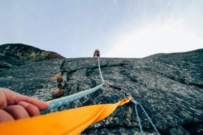 belaying your climbing buddy safely from the bottom