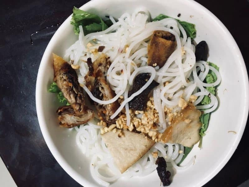 Vietnamese noodles with cut up spring rolls
