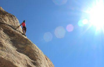 Lady Climbing A Mountain
