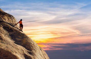 climbing woman mountains